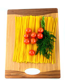 pasta , tomatoes and dill on a wooden background