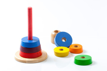 Stacking rings wooden toy, on white