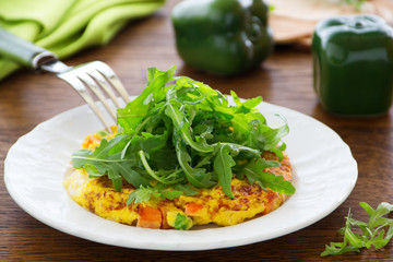 Frittata with vegetables and arugula.