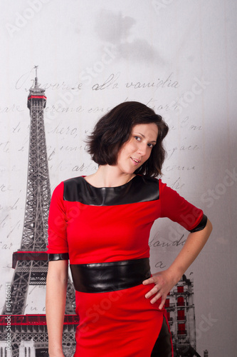 young flirtatious woman in red dress