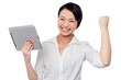 Excited businesswoman holding touch pad