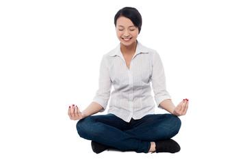 Pretty woman doing meditation