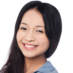 Young smiling chinese woman posing casually