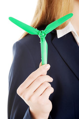 Beautiful caucasian business woman with green propeller.