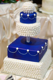 Blue wedding cake decorated with flowers