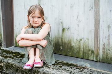 Angry little girl portrait outdoors