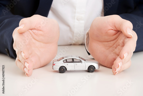 Close up on car toy model between hands.