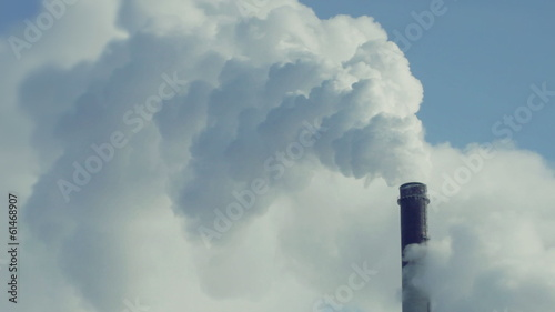 Industrial smokestack pollute atmosphere