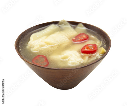 Wonton soup with chili in wooden bowl,asian cuisine, isolated