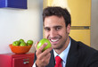 Attractive latin man eating an apple
