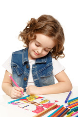 Cheerful little girl with sketch pen drawing in kindergarten