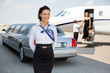 Attractive Airhostess Standing Against Limousine And Private Jet - 61470393
