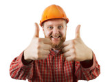Cheerful man in an orange construction helmet