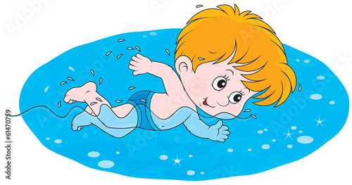 Little boy swims in blue water
