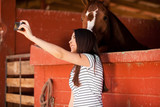 Taking a selfie with a horse poster