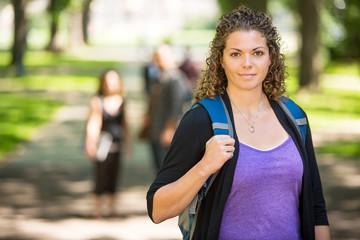 Confident Female Student Standing At Campus