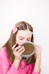 Girl with lipstick and mirror