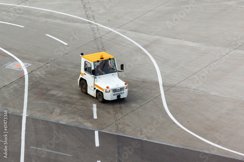 tug and luggage on the airport tarmac