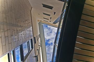 Summer sky peaking through modern building