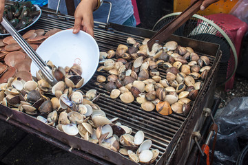 Stall with mussels near Ampahwa floating market