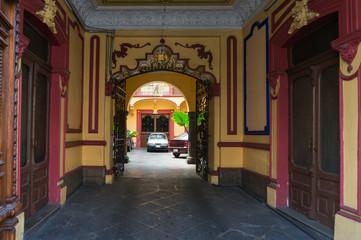 Colonial passage into courtyard in Pueblo, Mexico