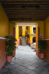 Colonial passage into yellow courtyard in Pueblo, Mexico