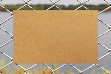Brown paper on metal fence