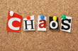 The word Chaos on a cork notice board