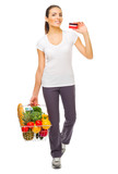 Young smiling girl food basket and credit card