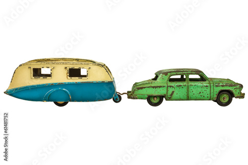 Vintage toy car with caravan isolated on white