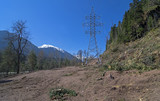 Transmission line under construction in mountains.