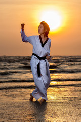 Taekwondo training at sunset