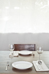 Bright dinner table setup for two