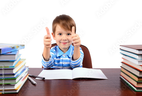 boy at the desk shows thumbs up