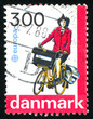 Postwoman on bicycle