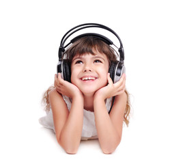 Little girl in headphones listening to the music