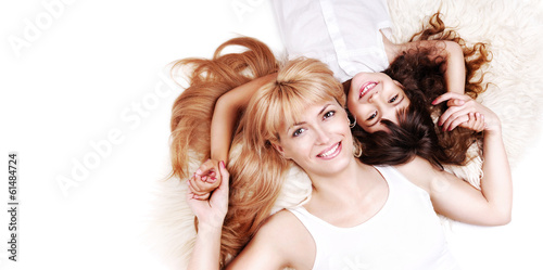 beautiful mother and daughter on white background top view