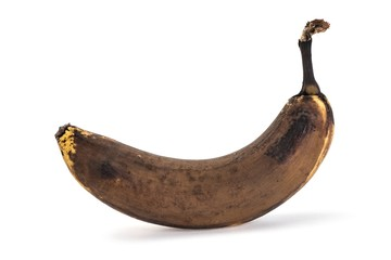 Side view of old overripe banana on white background