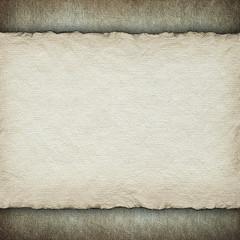 Blank paper sheet on grunge background