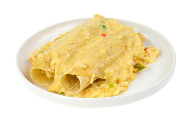 Chicken enchiladas with rice and cheese sauce