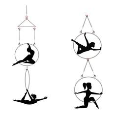 tandem aerial hoop dancers in silhouette
