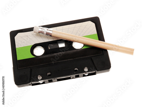 retro music audio tape with a pencil