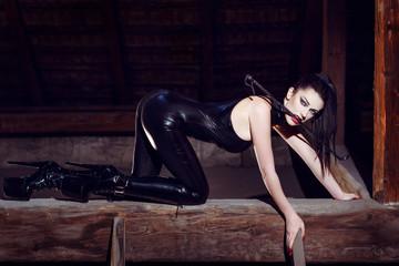 Beautiful fetish model kneeling in cat pose