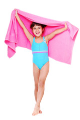Girl in a swimsuit isolated on white holding a towel