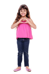 Portrait of cute girl making heart symbol with hands