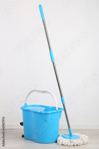 canvas print picture Floor mop and bucket for washing in room