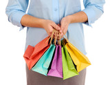 Young woman holding colorful shopping bags in  her hand,