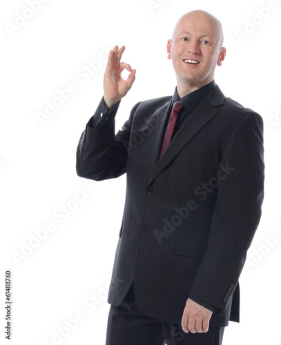 man in suit gesturing ok sign
