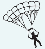 Man jumping with parachute
