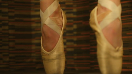Woman in ballet shoes standing en pointe